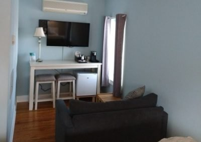 King room sitting area with mini-fridge, coffee, HD TV